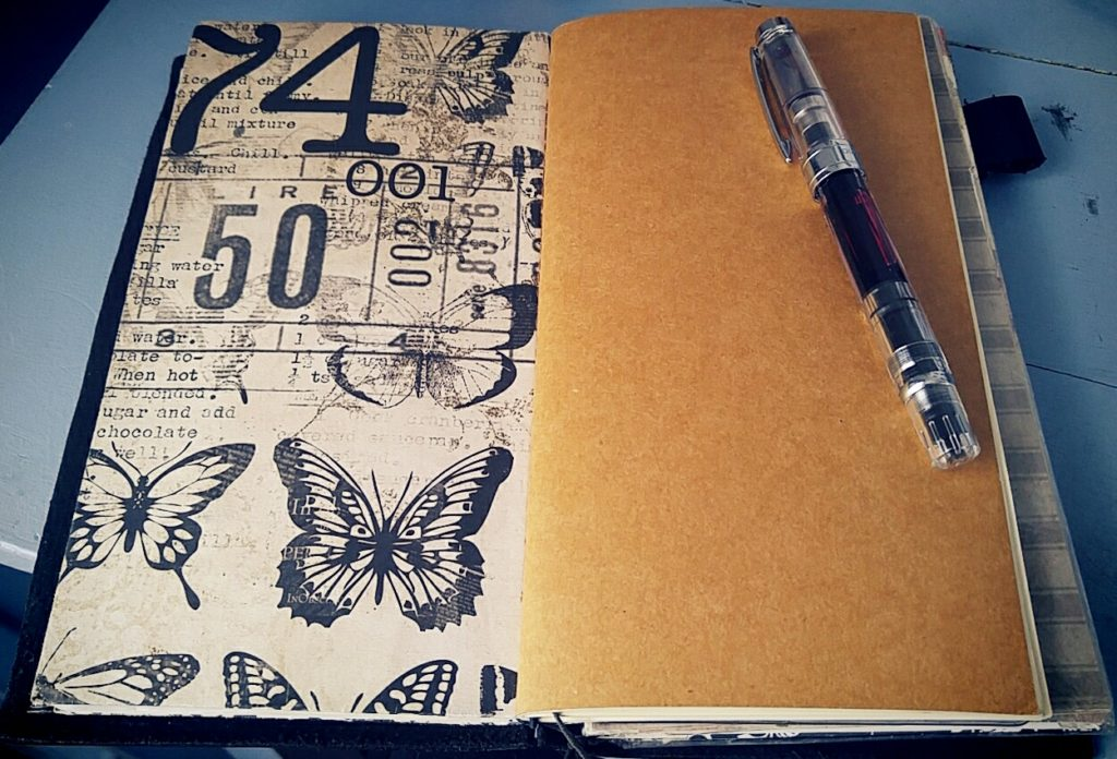 Writing journal (right) and my writer's notebook (left) in my Midori TN